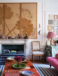 Love love living this dream Parisian apartment with that amazing mix of vintage textiles.