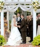 Outdoor gazebo wedding with garden flowers