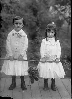 Boy in a dress with a girl in a dress too. From a glass negative. c.1910
