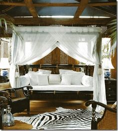 Not the zebra-print rug. Everything else.  British Colonial Bedroom Decor | Home Interior Design