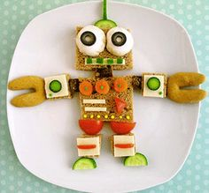 This adorable veggie robot will wow your picky eater. Play to their imagination with food! Cute Snacks, Cute Food, Good Food, Yummy Food, Food Art For Kids, Cooking With Kids, Toddler Meals, Kids Meals, Kreative Snacks