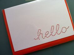 hand-punched 'hello' cards. they were designed by painted fish studio and are available on cargoh.com. excellent quality and i love the electric orange envelopes.