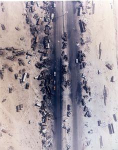 """An overhead view of the infamous """"Highway of Death"""", the name given to Highway 80 following the carnage visited upon the Iraqi forces who used it as they retreated out of Kuwait, 1991"""