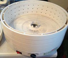 """Make my own yogurt maker!   (Cultures for Health says: Tina shared this ingenious DIY yogurt maker design with us recently.  She turned her round dehydrator into a yogurt maker by having her """"hubby remove the prongs from 3 of the trays, so it's hollowed out for my yogurt cups. Working like a charm."""" )"""