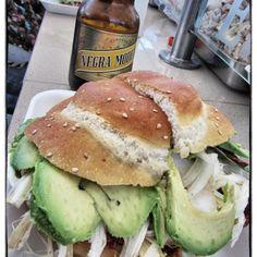Cemitas en Puebla.  Es un tipo de pan enorme típicos de Puebla relleno con una Milanesa frita, queso blanco en hebras deshilachadas, pápalo (hierba aromática muy intensa) y chile Chipotle (chile ahumado).  http://www.onfan.com/es/especialidades/puebla/mercado-del-carmen/cemitas?utm_source=pinterest&utm_medium=web&utm_campaign=referal