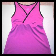 """NWOT Champion Workout Top Tag says a size S. But it is really an XS. I waited too long to return it. The color is a deep magenta. My camera makes it look more hot pink. It's so cute, but I never wore it to the gym.   Pit to pit 12"""". Pit to hem 15"""", so it's nice and long. It is 90% polyester and 10% spandex. Super cute! The bra area is lined. Champion Tops"""