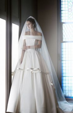 KATE ELIN http://WWW.SONYUNHUI.COM  Royal, Mikado silk wedding dress. Bodice with off-the-shoulder. Simple and classic wedding dress. Skirt gathered at the waist. Love the satin band edging the veil.