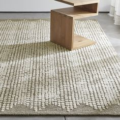 Shop Clea Wool-Blend 5'x8' Rug.  Raised tufts on a looped ground of natural undyed wool-blend yarn create a textural pattern inspired by chalky rock cliffs.  The ground creates a solid, scalloped border to frame the rug's dynamic, freeform pattern.