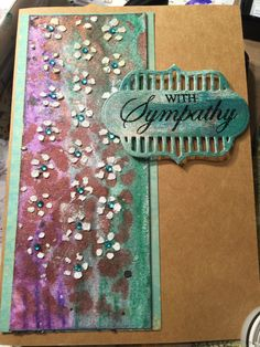 Mixed media sympathy card...I used modeling paste for the flowers. And some tiny bling for the centers.  And the background is watercolor paper with viva metallic colors