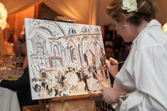 How cool to have an artist painting the scene at the wedding reception.
