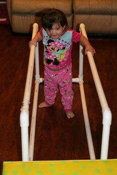 We are trying to encourage walking & after a fun trip to The Little Gym, hubby built this contraption out of PVC pipe. Quick, simple, cheap & she LOVES it!! :)