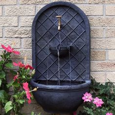 Messina wall-mounted waterfall fountain feature with iron finishEasy to hangRelaxing outdoor accentLightweight polystone constructionIncludes: solar pump, wall fountain, and a submersible electric pumpThis outdoor solar wall fountain is perfec Outdoor Wall Fountains, Outdoor Walls, Outdoor Decor, Patio Fountain, Garden Fountains, Garden Ponds, Koi Ponds, Solar Fountains, Backyard Water Fountains