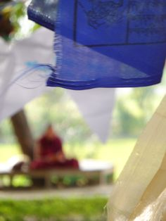 A monk in the background in Lumbini