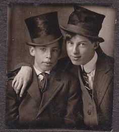 Boys wearing top hats for fun. As adults they'll wear them for real.