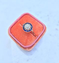 Edwardian sapphire halo and diamond star ring - conversion piece! 18k and platinum, rose cut diamond, and calibre sapphire. by OtherwiseEngaged on Etsy https://www.etsy.com/listing/248994371/edwardian-sapphire-halo-and-diamond-star
