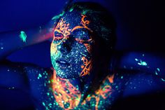 Daria Khoroshavina is a Russian photographer who came up of an artistic series she entitles We are all made of stars. In this series, she pushes creative photography by capturing body painting illuminated under black light. As a result, the paints react to the light and glow in vibrant colors; her works aims to make a chaotic resemblance of space and the sky. Scroll down and check out some of her bizarre photography. Come, take a peek, and enjoy.