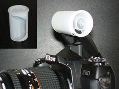 Homemade flash diffuser use a film canister.  Good idea and small enought to carry in your pocket.