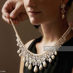 A model wears a Gulf Pearl Necklace at Christies auction house on September 6, 2006 in London, England. The necklace, part of the 'Harry Winston' suite, is the considered finest range of drop pearls to appear on the market in over 100 years and has an estimated value of USD20m.