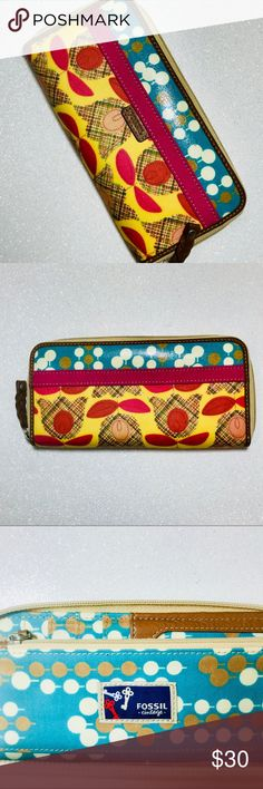 """Fossil Full Zip Coated Canvas Leather Wallet Fossil Full Zip Coated Canvas Leather Wallet. Leather zip pull. 7.5"""" long 3.5"""" wide. 17 cars slots. Inner zip pouch. Inner leather accents. Slight pink markings one two of the card slots. Overall excellent condition. Don't be shy with Offers. Thank you for looking! Tulip and tree print. #52 Fossil Bags Wallets"""