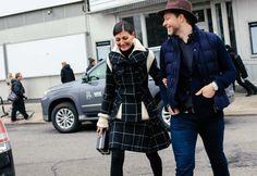 Giovanna Battaglia in a Sacai coat and skirt, with an Alexander McQueen bag and Derek Blasberg