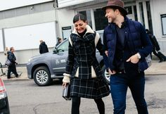 Giovanna Battaglia in a Sacai coat and skirt, with an Alexander McQueen bag and Derek Blasberg