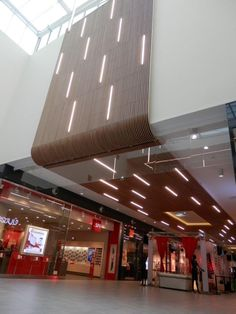 Increasing turnover in shopping malls through warm materials such as Laudescher timber ceilings. Atrium Design, Entrance Design, Facade Design, Mall Design, Lobby Design, Retail Design, Canopy Architecture, Light Architecture, Architecture Design