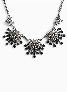 """A really good statement necklace can change a whole outfit for the better...and we think this statement stunner is the one. The chunky hematite chain is totally art-deco chic with black, grey and opaque gemstone clusters.<div><ul><li style=""""list-style-position: inside !important; list-style-type: disc !important"""">Lobster clasp</li><li style=""""list-style-position: inside !important; list-style-type: disc !important"""">18"""" long with 5"""" extender</li><li style=""""list-style-position: inside…"""