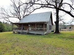 Perfect Get-a-way in this rustic cabin sitting on 26 acres. This property has a well fed pond, sitting behind the cabin. A perfect place to cast a line overlooking the pasture land, as well as , another pond in the back pasture surrounded by small pines. The pasture land is fenced and crossed fenced. This property has 2 barns to put your hay, tractor or suvs. Don't miss this rare listing. Call your agent today to set-up your showing appointment.