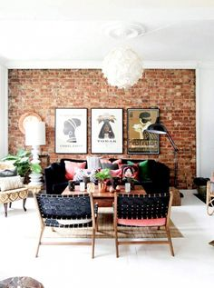 This bohemian Scandinavian home expertly uses black and pink as a foil exposing red brick walls. Textural velvets and leathers intermix with warm woods while rose-gold accessories add depth to the space.