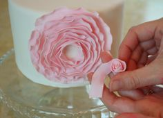 Fondant/gel paste ribbon flower tutorial.  You may be able to use this recipe for the ruffles on the Ruffle cake. I think you might have to form the large ruffles and let them dry before applying to the cake to avoid sagging. Experiment first.
