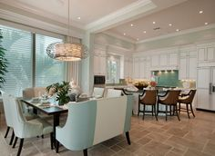 Kitchen open to dining. Turquoise/aqua/teal accents. Love the dining benches and much more. House of Turquoise.