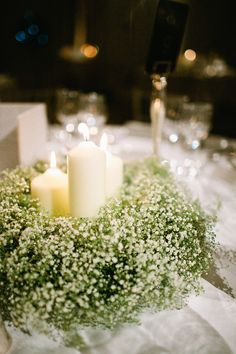 Wedding Decor: Lots of candles + LOTS of baby's breath! See the wedding on #SMP: http://www.stylemepretty.com/2013/12/23/claridges-london-winter-art-deco-ballroom-wedding/  Jodie Chapman Photography