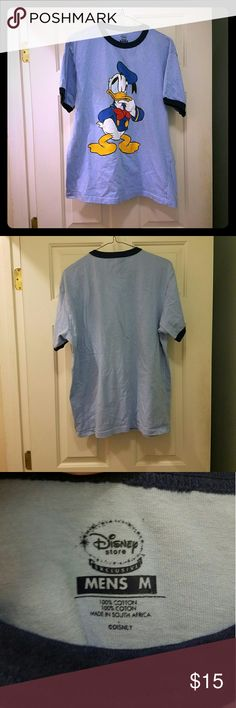 Donald Duck Disney Ringer Short Sleeve Shirt Really nice Donald Duck ringer style t shirt from The Disney Store!! Light blue with navy blue trim on sleeves and neck. In great used condition! Men's size Medium. Feel free to ask any questions!  All my items come from a smoke free but dog and cat friendly home. Disney Shirts Tees - Short Sleeve