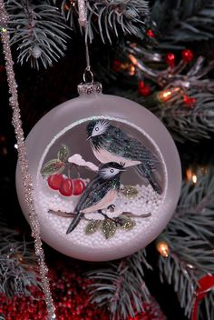 Beautiful frosted glass ornament with hand painted pair of blue birds and bright sparkling glitter resting on branch with red berries and fallen snow at Freehold, New Jersey | Photo by Joyce StJames with Pin-It-Button on FineArtAmerica