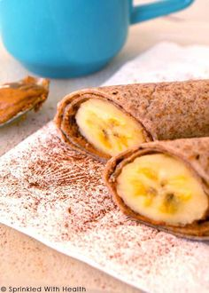 Spiced peanut butter and banana roll-up - Spread all natural nut butter on a whole grain tortilla, and place a peeled banana at one edge of it. Sprinkle with cinnamon, then roll it up for a nutritious and portable meal.