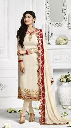 Exclusive Off White Mouni Roy Long Kameez With Floral Rose Work Dupatta AN113506 Stylish off white georgette churidar suit which is imposingly made with zari, resham, embroidery, stone and lace work. This attire comes with matching bottom and dupatta. This unstitched suit can be stitched in the maximum bust size of 44 inches and kameez length is 46 inches