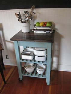 A French Touch: SOLD - Kitchen Cart:  The lady stated she found the cart at a thrift store...it's from Ikea.  I recognize our kitchen cart anywhere.  I gotta admit though, it's an awesome buy, solid pine, unfinished for 50 bucks.  I've been thinking of finishing it.