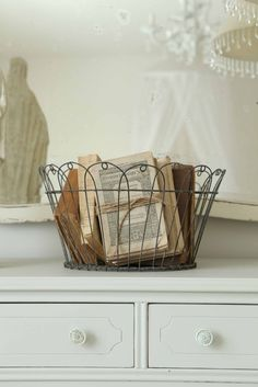 vintage books in wire basket. Twine wrapped around book :)
