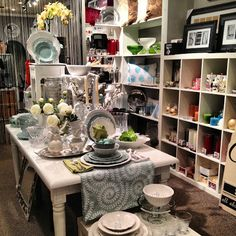 Spring Table :: Visual Merchandising  idea,,stack from wall/door higher and lower in front...