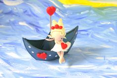 Hey, I found this really awesome Etsy listing at https://www.etsy.com/listing/463104849/figurine-on-boat