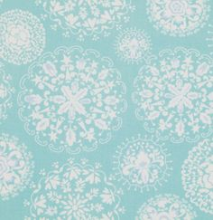 A very pretty white doily print on pale aqua from Dena Designs!    This unique ornamental design will look great made up into sha