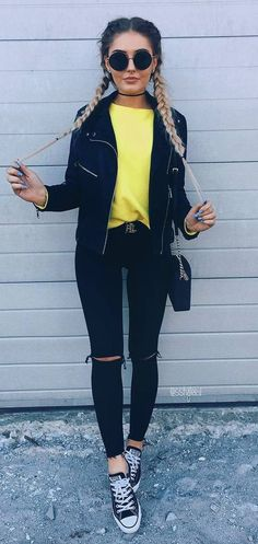 incredible fall outfit / yellow sweater + moto jacket + rips + converse + bag