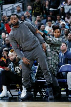 When it comes to Black love, LeBron and Savannah James come to mind. The super couple created super children, who are all talented in their own right, but it's this picture of King James and Savannah cheering for Bronny that has gone viral. Lebron James Lakers, Lebron James Finals, Lebron James And Wife, Lebron James Family, Nba Players, Basketball Players, Black Love, Black Men, Basketball Couples