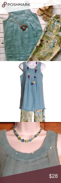 Long Teal Linen Sequined Tunic Tank Top or Dress Beautiful and NWT (tags are attached with a safety pin). This 100% linen tunic has drawstrings at the bottom and sequins around the neckline. Can be worn as part of a Lagenlook outfit or even as a short dress. Measures 17 inches across from armpit to armpit and 28 inches in length. Size is XS or 2/4. Depending on your measurements, this might also fit a size Small. Tops