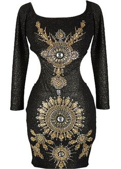 Beaded Cleopatra Dress: Features a double wide scoop neck framed by elegant 3/4-length sleeves, sexy side cutouts and open back for ample exposure, elaborate medallion-inspired embellishment to the front, and a beckoning body-conscious silhouette to finish.
