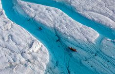 The icy island attracts explorers, scientists and adventurers. The Blue River is one of the greatest places to kayak. The melting Petermann Glacier fills in the lower areas of the glacier and creates a clear blue water river. Greenland Travel, World Geography, Amazing Pics, Aerial Photography, Natural Wonders, Nature Photos, Beautiful World, Arctic, Wonders Of The World