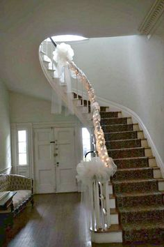 My reception venue features a huge staircasepossibility stair well decorated for our wedding thanks to my bridesmaids junglespirit Images