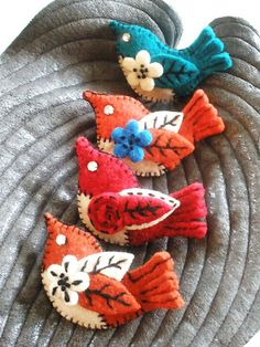 Felt bird brooches by woolly  fabulous, via Flickr