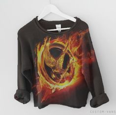 hunger games sweater…  brb dying at the thought of this being real