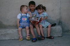 Children read Aid to the Church in Need's Childs Bible in Alqosh, Iraq